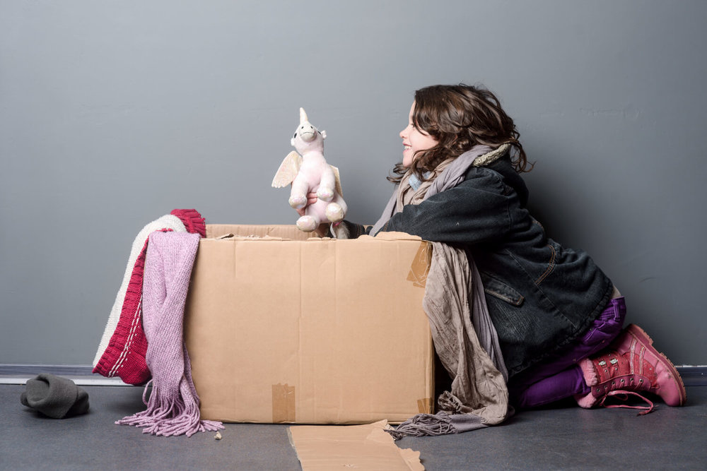 girl with unicorn - holiday charity ideas for moving companies