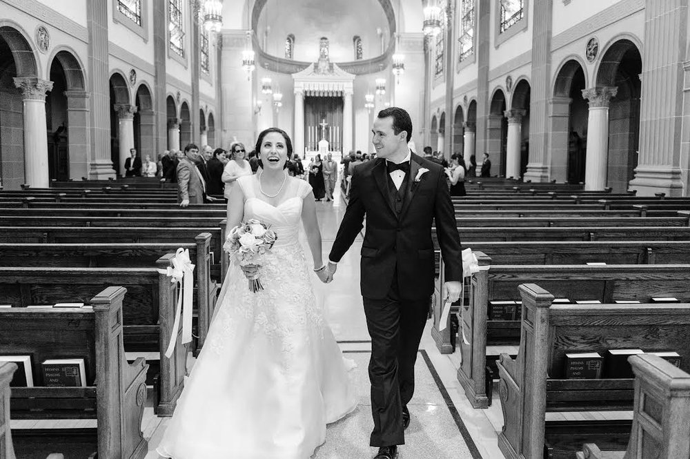 Andrea-and-husband-walking-down-aisle_Meet-Updater