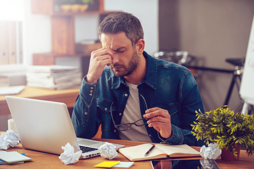 man frustrated - property manager burnout