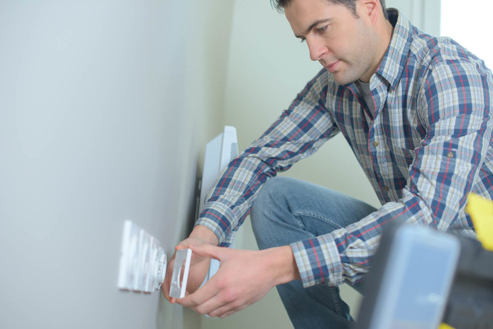 man fixes outlet - final walk through checklist