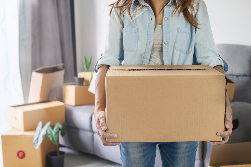 woman holding box - questions to ask moving companies.jpg