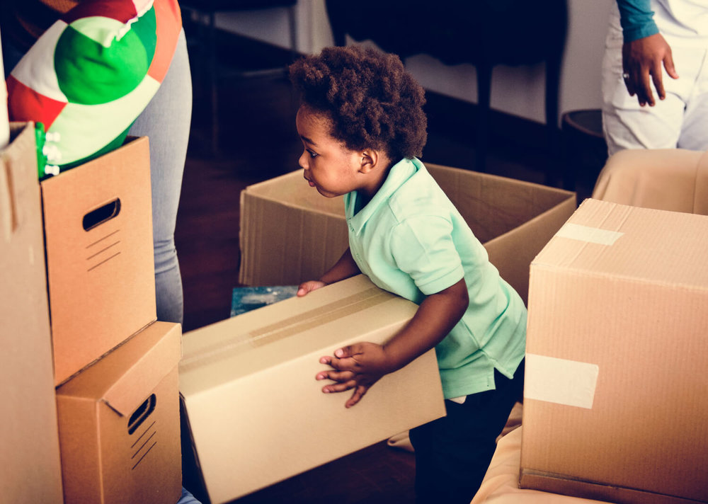 child with box - questions to ask moving companies.jpg