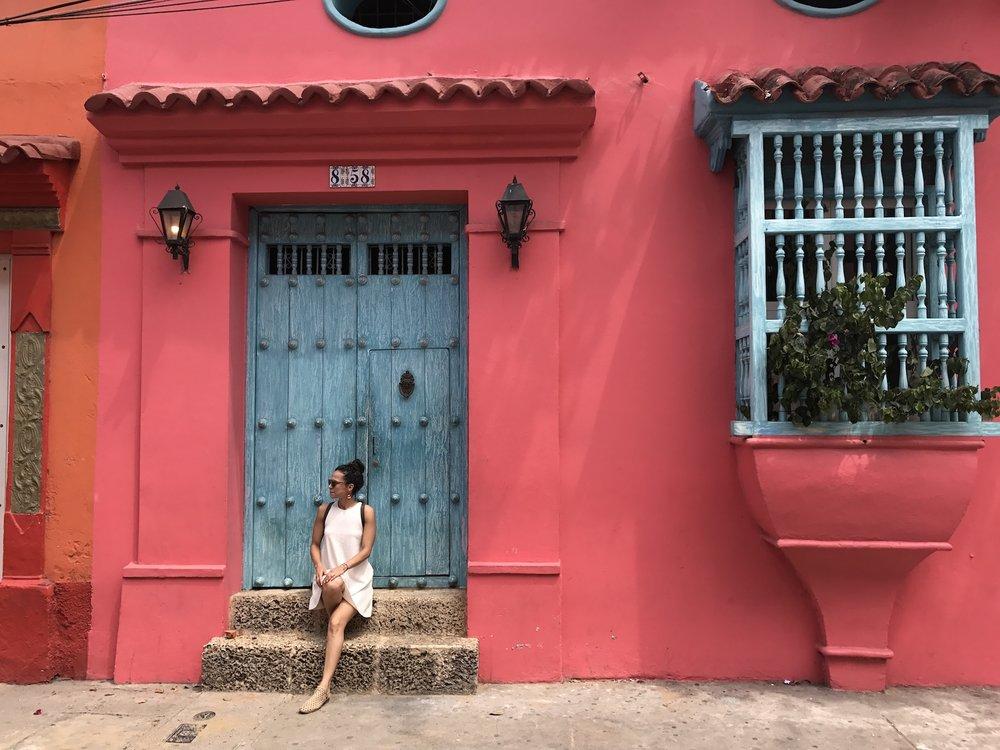 angela-in-front-of-blue-door_meet-updater-angela-medina.JPG