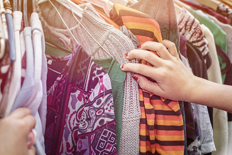 person-going-through-clothes_where-to-donate-clothes