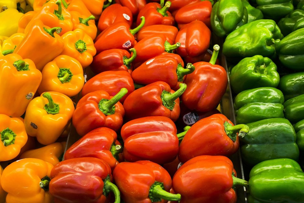 Alt-text: peppers-in-grocery-store_new-home-grocery-list