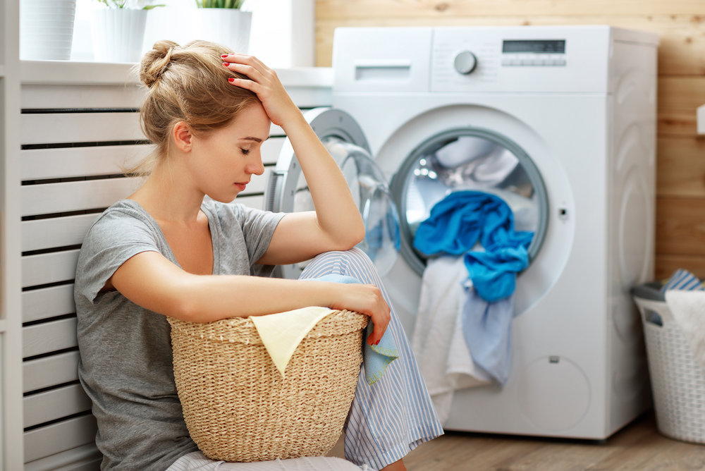 woman-laundry_what-is-a-home-warranty.jpg