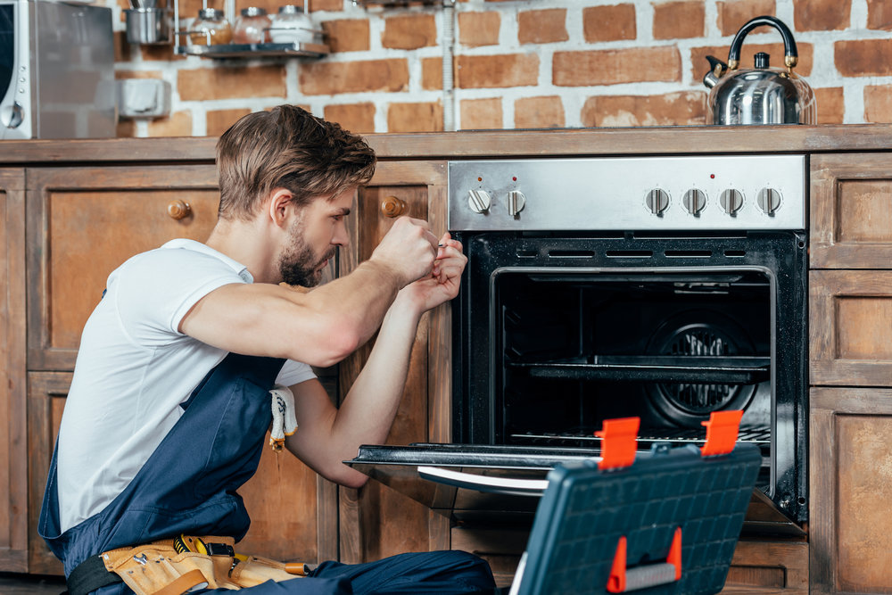 repairman-oven_what-is-a-home-warranty.jpg
