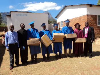 Bible distribution in Malawi supported by the Spread The Word Bible Program.  These pastors who have graduated from the 2 year Academy are each receiving a case of 20 Bibles to take to their church home.