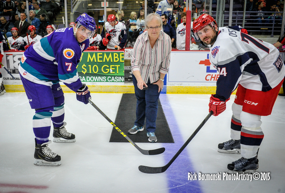 Jackals Captain, Nathan Oystrick and the Orlando Solar Bears Eric Baier during the ceremonial puck drop, for Drop The Puck on Hunger.