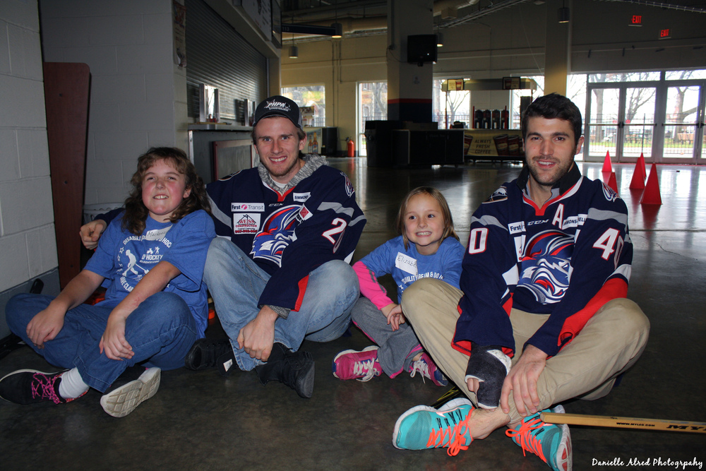 Nick Zappia and Taylor Stefishen pose with participants at the November 21st event