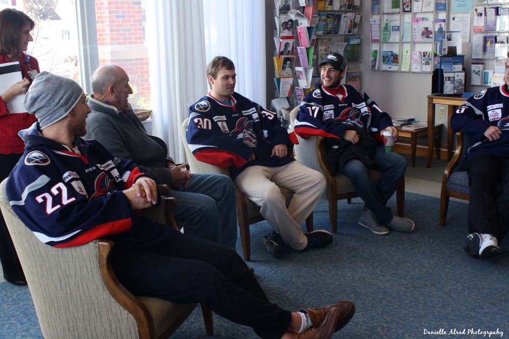Jackals Goaltender C.J. Motte shares a story with teammates and patients at the Arnot Health Falck Cancer Center on 11/23.