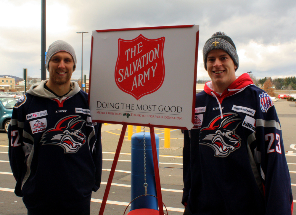 Forward Mark Bennett (left) and Defenseman Jacob MacDonald (right) ring the Salvation Army Bell in front of the Horseheads WalMart on December 3rd