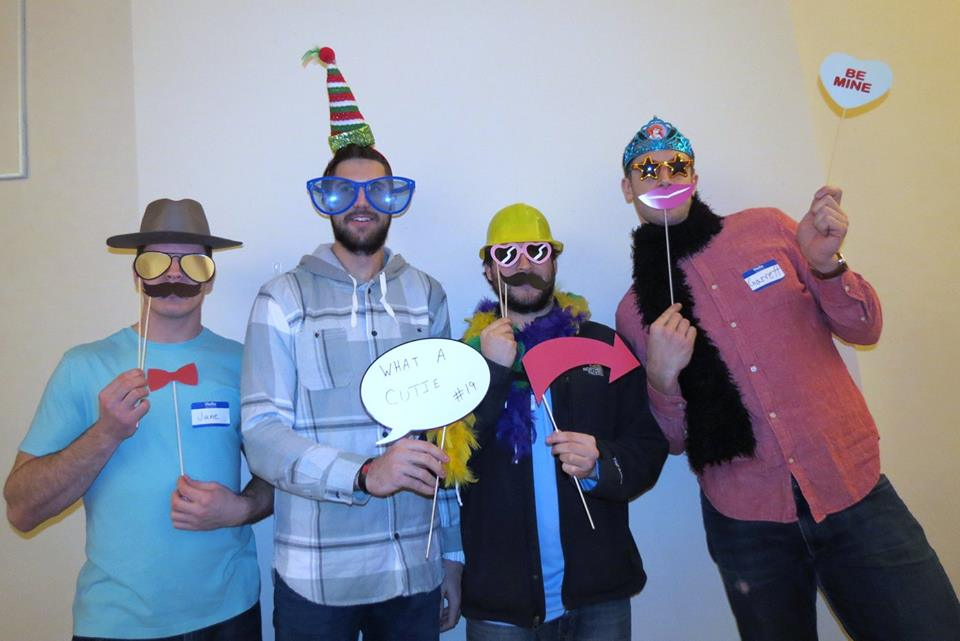 Left to right: Jacob MacDonald, Guy LeBoeuf, Mike Seidel, and Garrett Klotz play dress up at the Holiday Party.