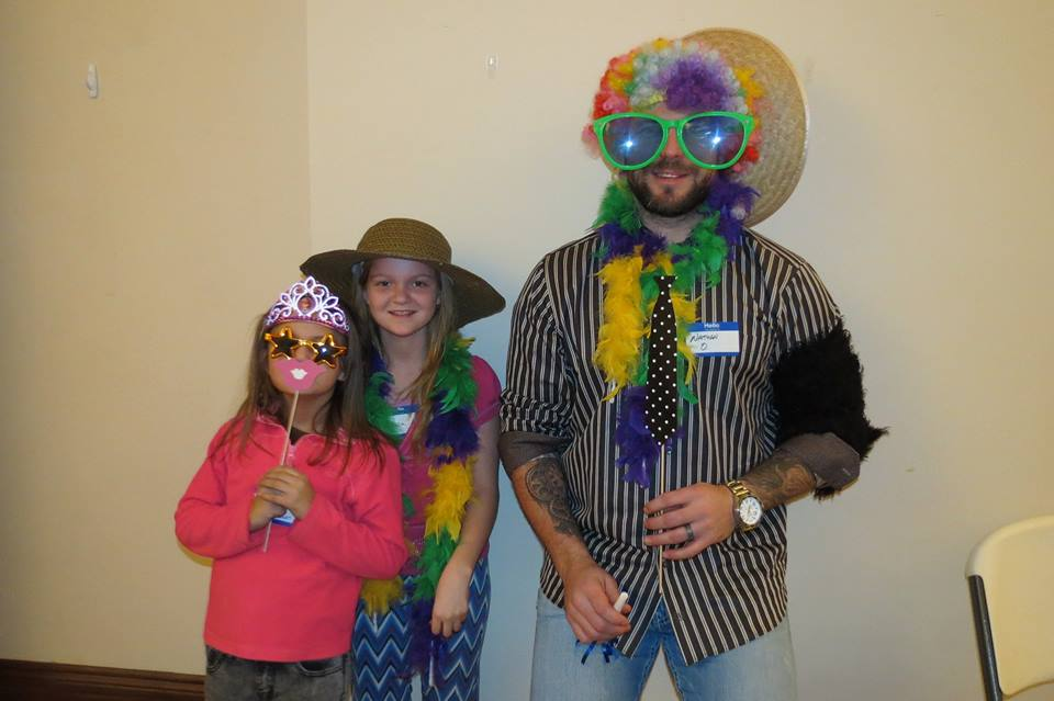 Nathan Oystrick plays dress-up with a few young fans