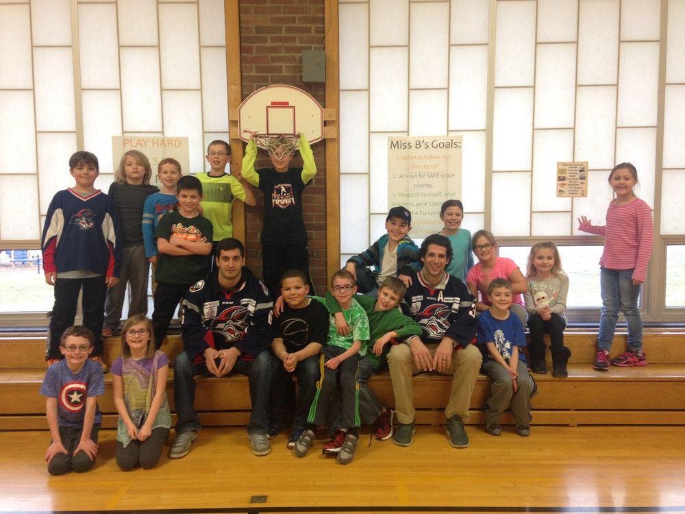 Spiro Goulakos and Nick Tuzzolino pose with some of the Center Street After School Program students.