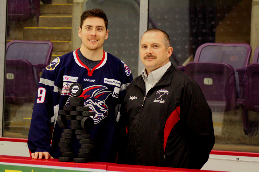 Allan McPherson presents Corning Youth Hockey representative Chris Daigler with a case of pucks from Sher-Wood Hockey.