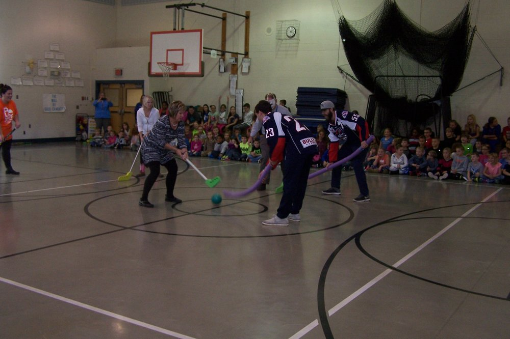 Jackals players play a pickup game of hockey, using pool noodles instead of sticks, at Cohen Elementary Nov. 10.