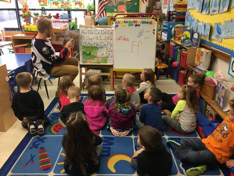 Mark Bennett reads to Mrs. Fuksman's Pre-K class.