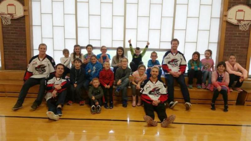 Kenton Miller, Mike Radja, Mark Bennett, and Colin Murray with a group of Center Street students.