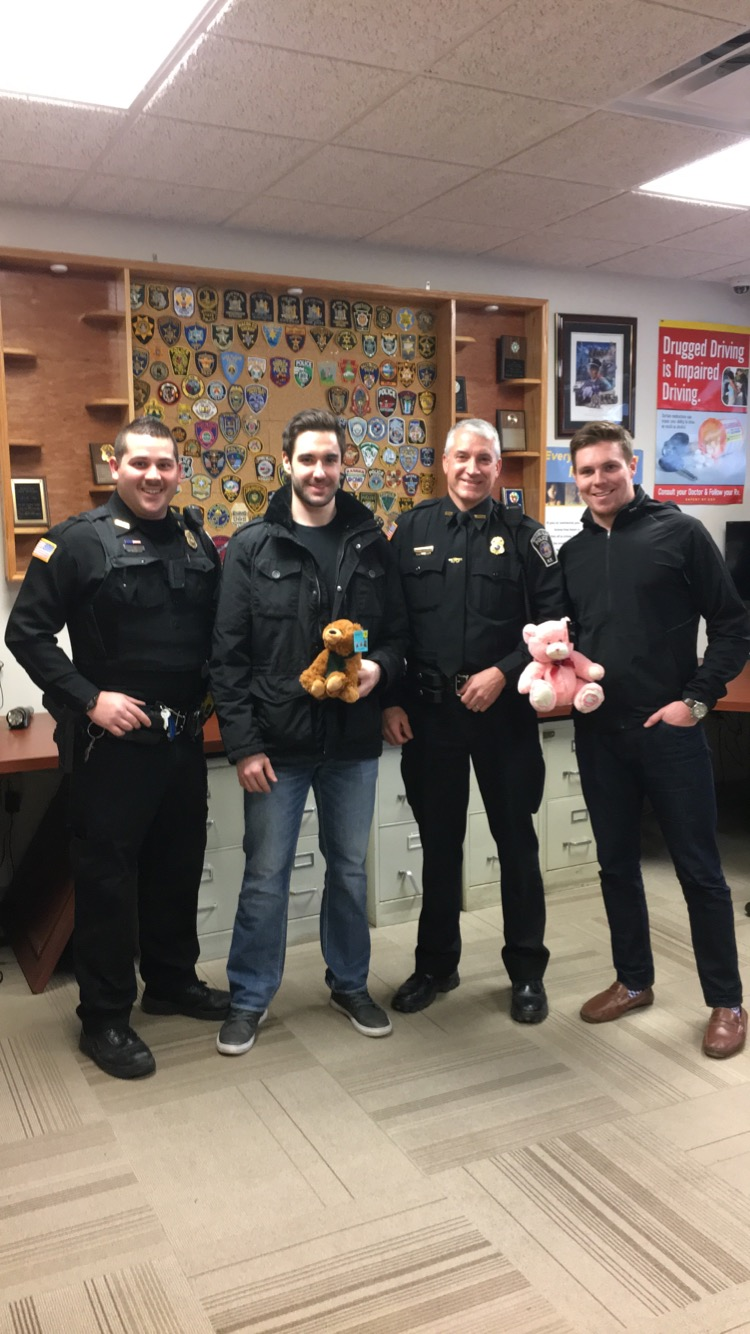 Ian Young and Kyle Rankin pose with Watkins Glen Village Police Officers Mosher and Waite.