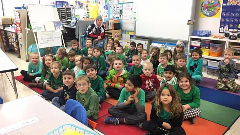 Matt Lane poses with a Gardner Road Kindergarten class