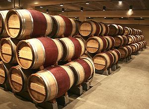 Oak wine barrels at the Robert Mondavi vineyar...
