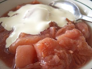 A bowl of stewed nectarines with cream, mm-mmm.