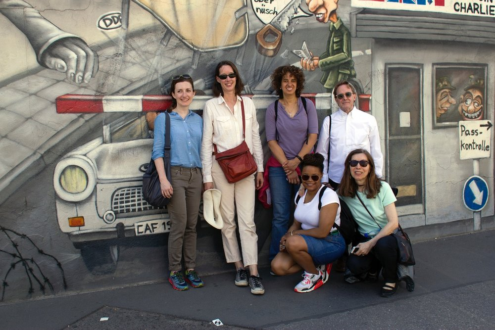 Cohort '15 with IDSVA Vice President, Amy Curtis at the East Side Gallery.