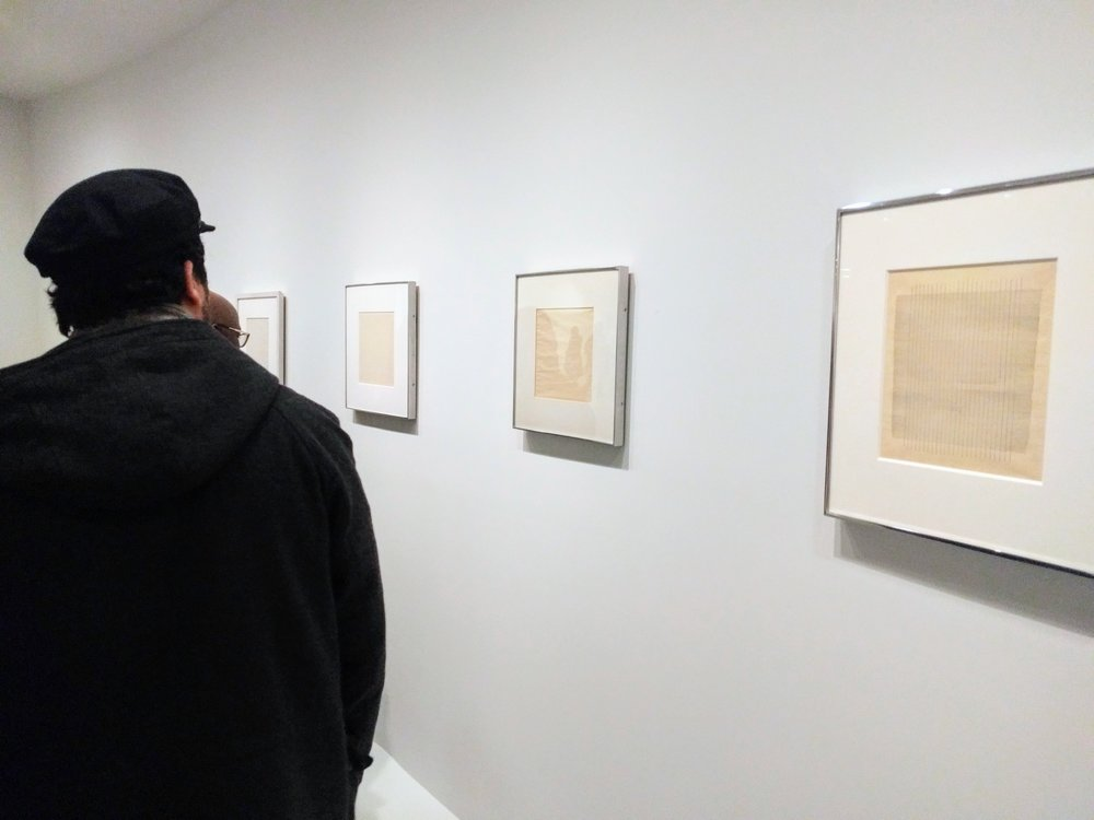 IDSVA student Milos Zahradka Maiorana examining some of Martin's drawings, Guggenheim, 2017. Photo by Jonathan Morgan