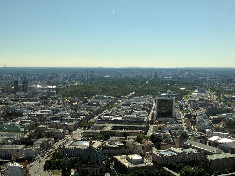 View of Berlin from the Fernsehturm with the Brandenburger Tor & Tierpark in distance  Photo Credit: Jonathan Morgan