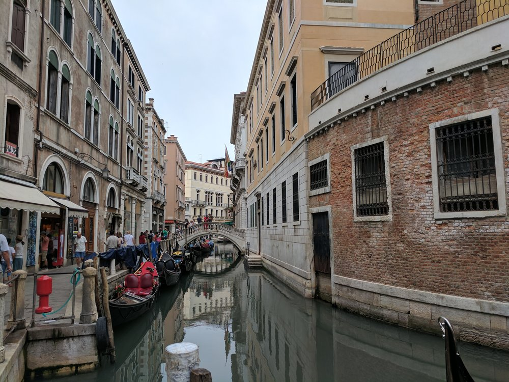 People walking along one of Venice's many canals  Photo Credit: Jonathan Morgan