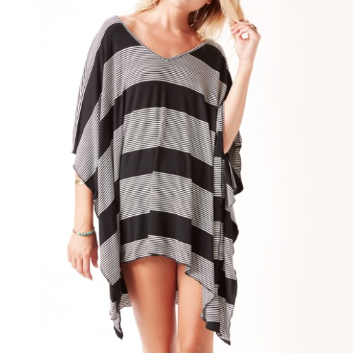 Blue Life V-Neck Striped Cape This striped cape features a long comfy silhouette. Pair with boots for an edgy look while running errands.