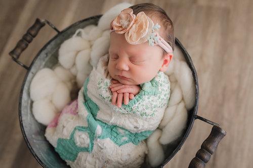 Baby in a bucket pose newborn photographer brooksville spring hill tampa