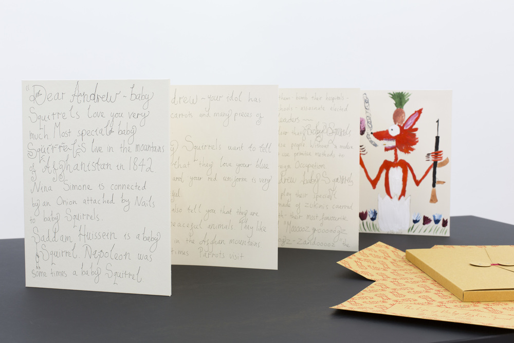 A hardcover leporello letter from the Holy Broccoli to Emperor Andrew Gilbert. It features seven paintings of Andrew Gilbert showing important stations in the life of Baby Afghan Squirrel.