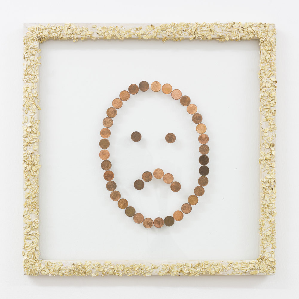 Anna McCarthy, Unhappy Oats, 2013, wood, glass, oat flakes, coins, 38 x 38cm