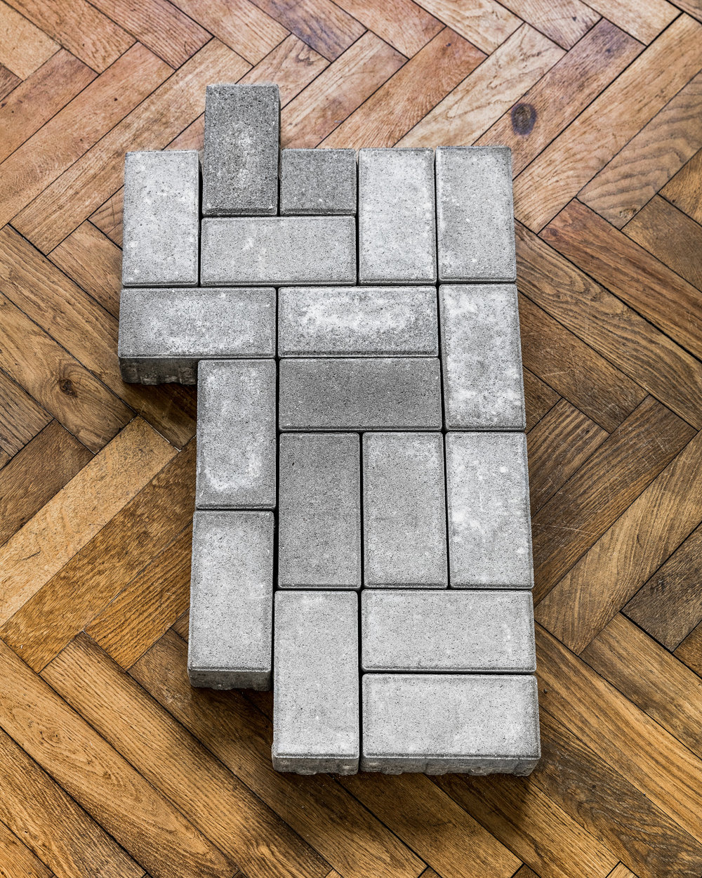 Thomas Geiger, A stage for unscrupulous behaviour, 2017, concrete paving stones, adhesive letters, 90,5 x 49,5 x 8 cm