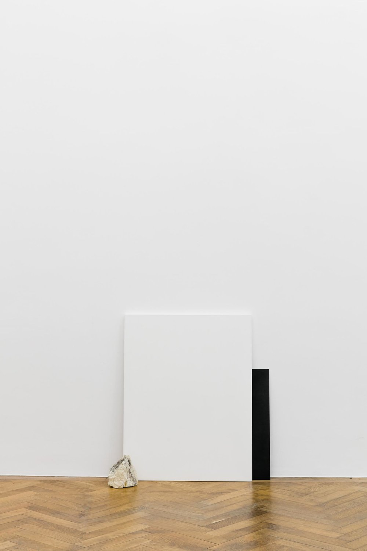 Haris Epaminonda, Untitled #02 t/f, 2014, white pastellone (90 x 70cm), iron plate (60 x 40cm), stone (18 x 16 x 9,5 cm)