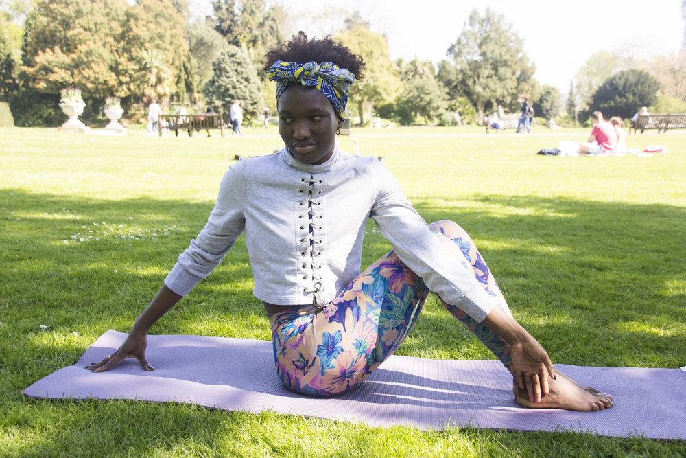 Adeola practising yoga in Regent's Park