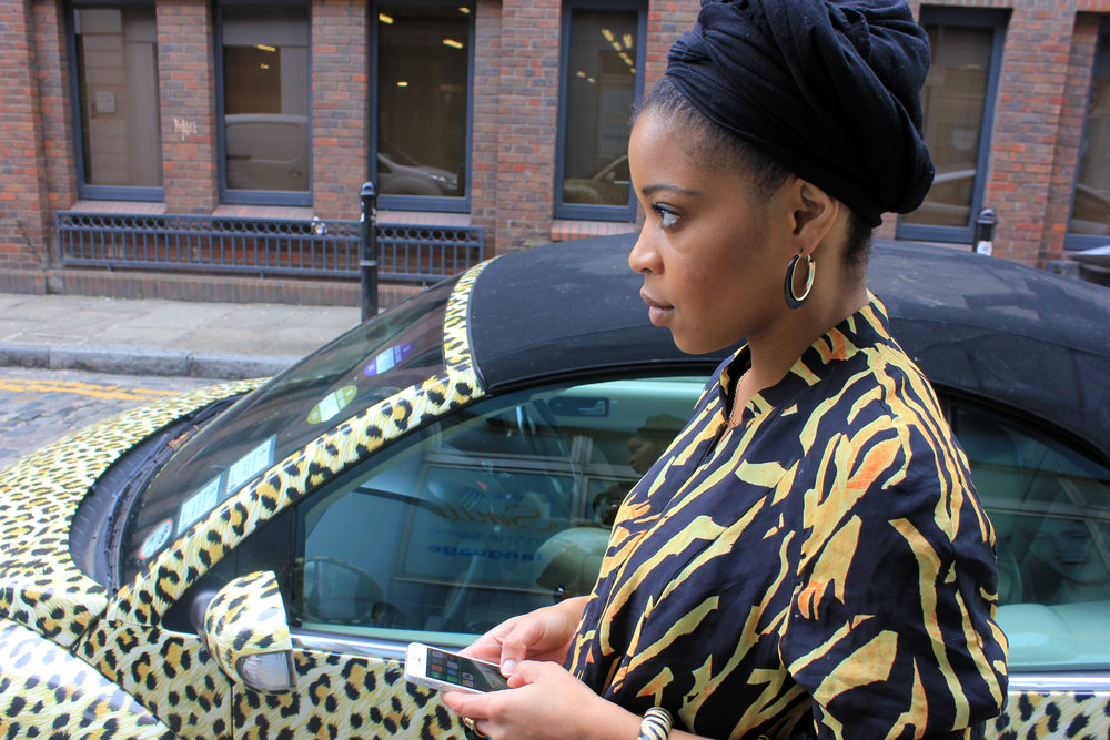 Michelle Duberry rocking Yemzi bomber in front of a leopard car #prints