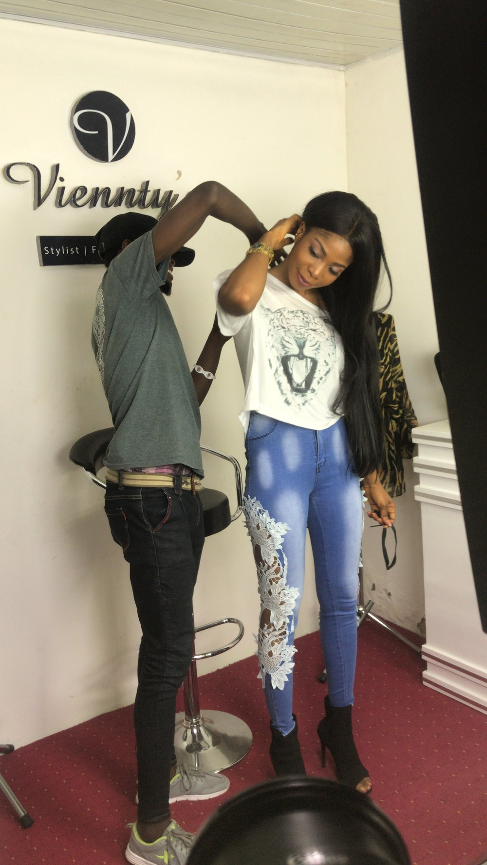 Edem wearing Yemzi on the set of Viennty's