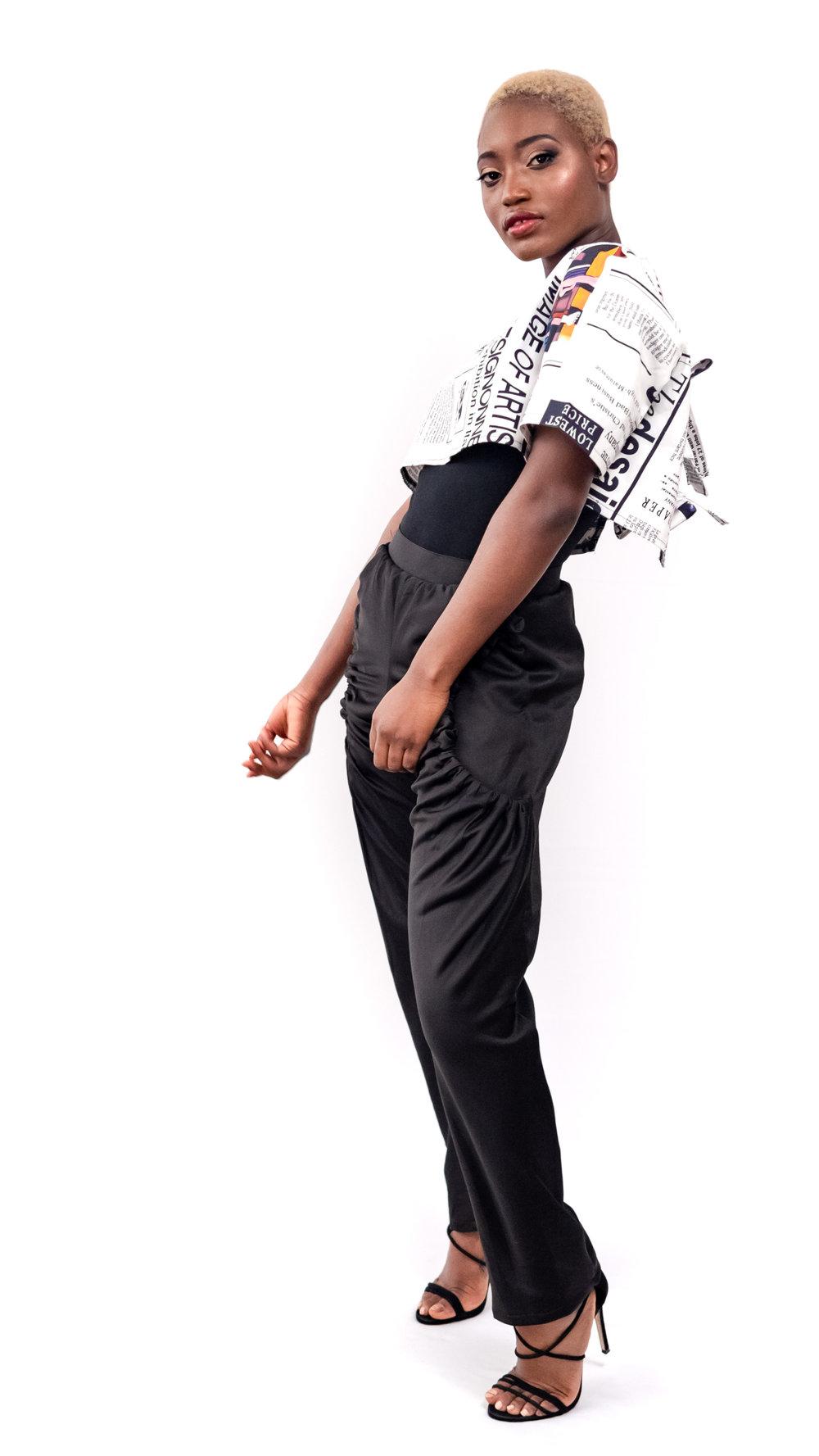 A model wears a Kim Dave design