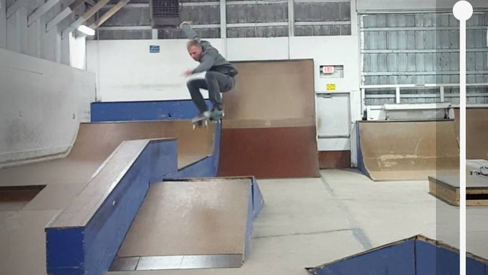 An OG- approved athlete getting huge air on a skate park trick.