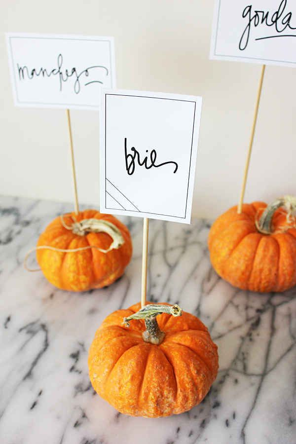 Mini Pumpkins, Skewers, Paper, Sharpie (weddingomania.com)