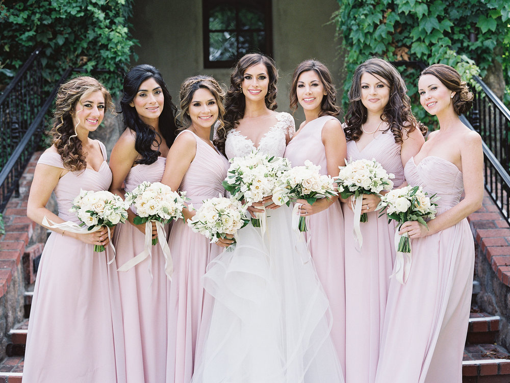 The Beautiful Bride Wore Ultimate Flowy Gown By Hayley Paige That Paired Perfectly With Her Loose Hand Tied Bouquet Of Ivory Garden Roses Ranunculus