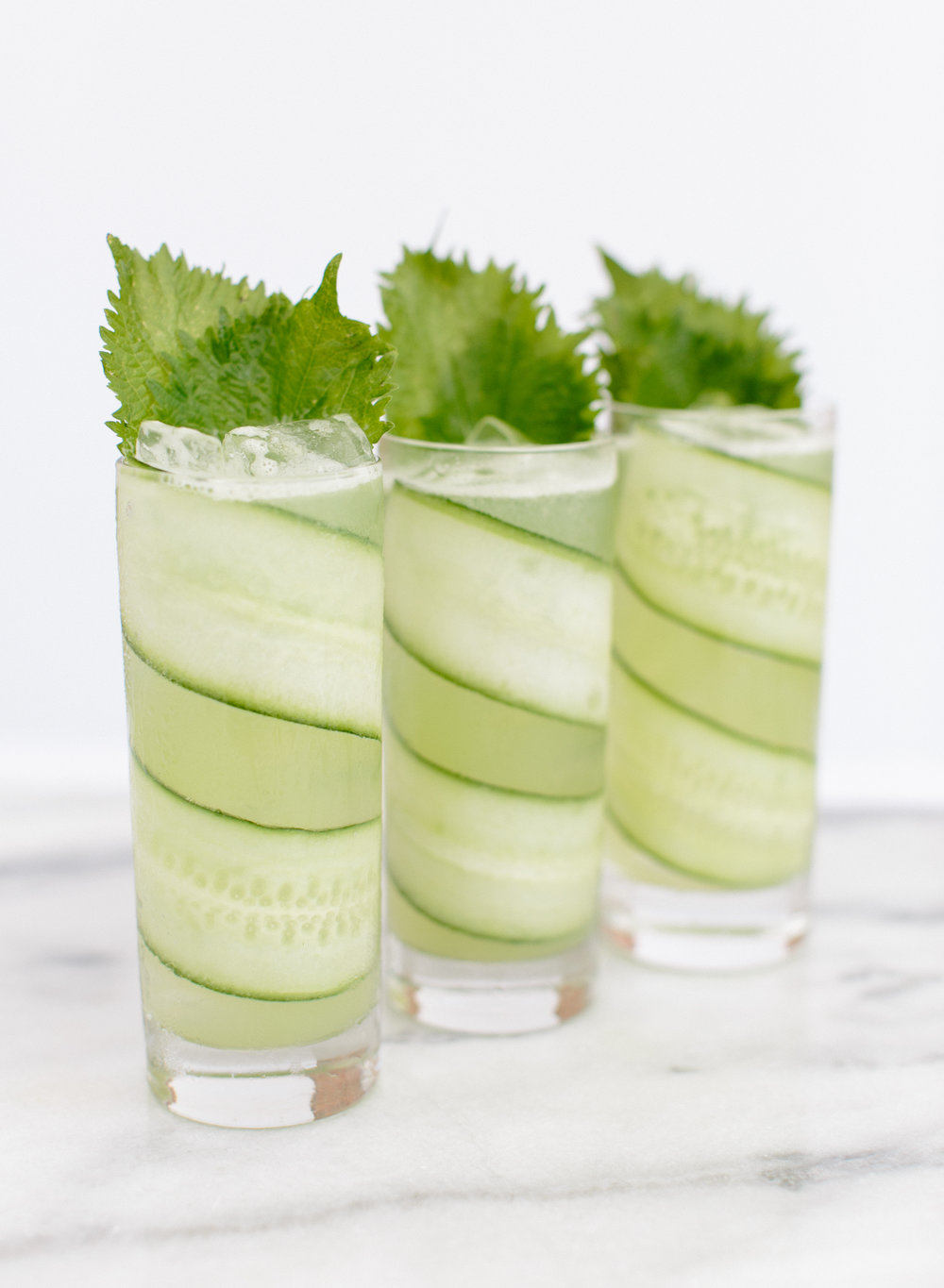 The Green Whisper - Glass – highballMethod – shake and strainGarnish – long thin cucumber spiral; 2 shiso leaves2 oz. vodka or gin1.25 oz. fresh English cucumber juice.75 oz. fresh lime juice.75 oz. house-made green peppercorn syrup