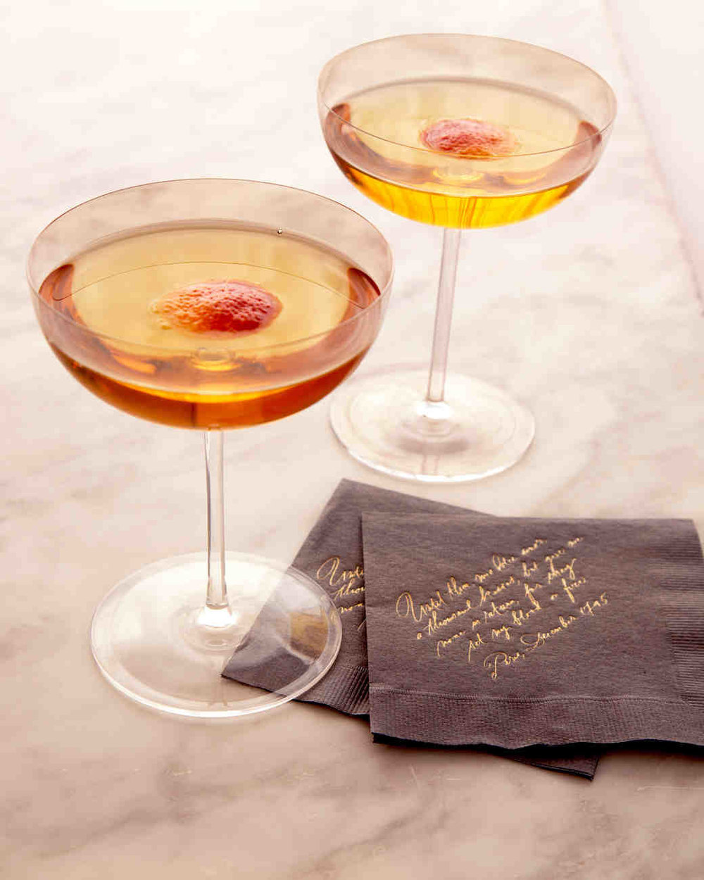 Fall Manhattan - Serve a seasonal drink made with rye, Champagne, bitters, blood orange, and maple syrup.
