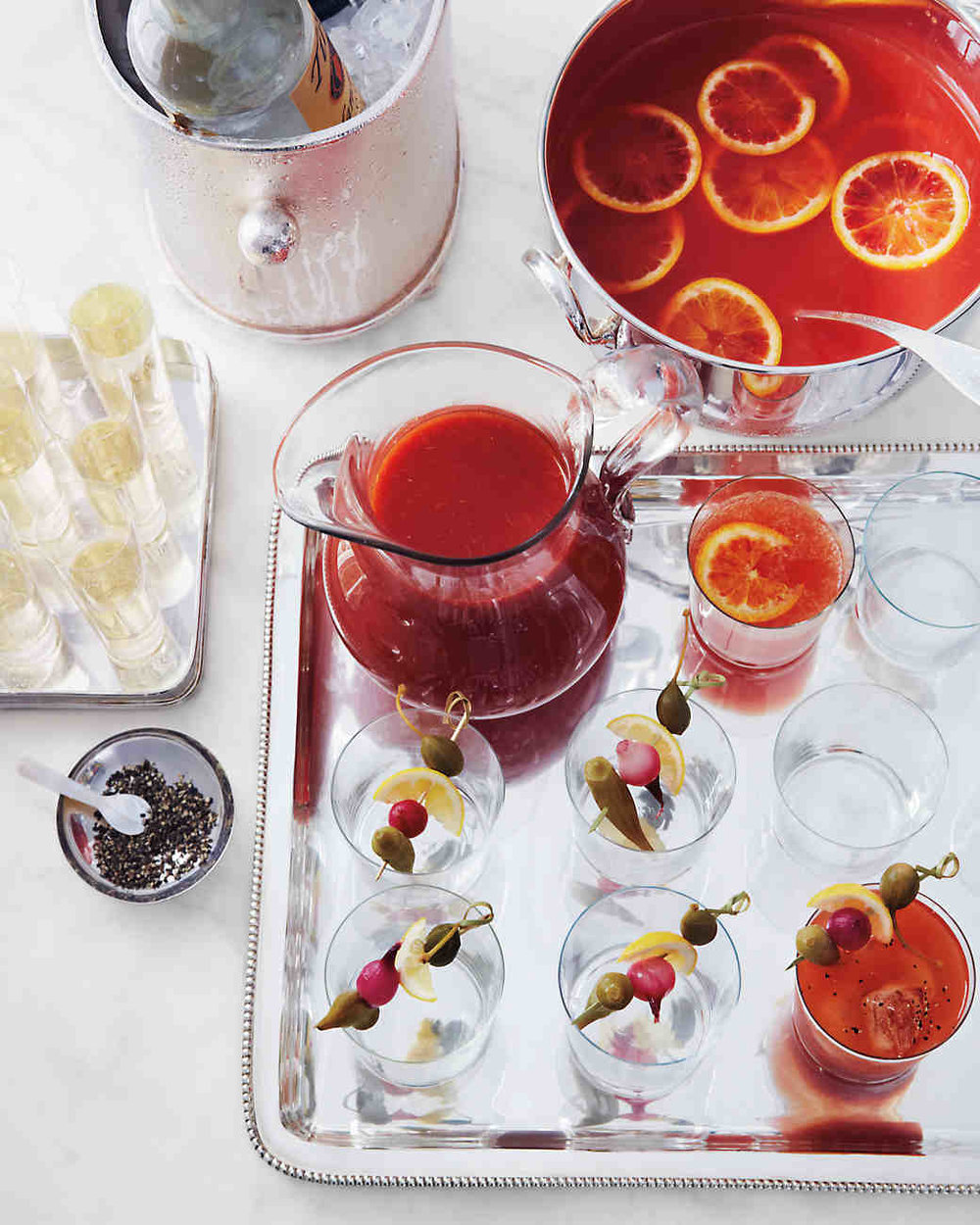 Mulled Blood-Orange Punch - Blood-orange juice and spices combine for a wonderful fall mixture. Serve as is or topped with sparkling wine, sparkling water, or vodka.