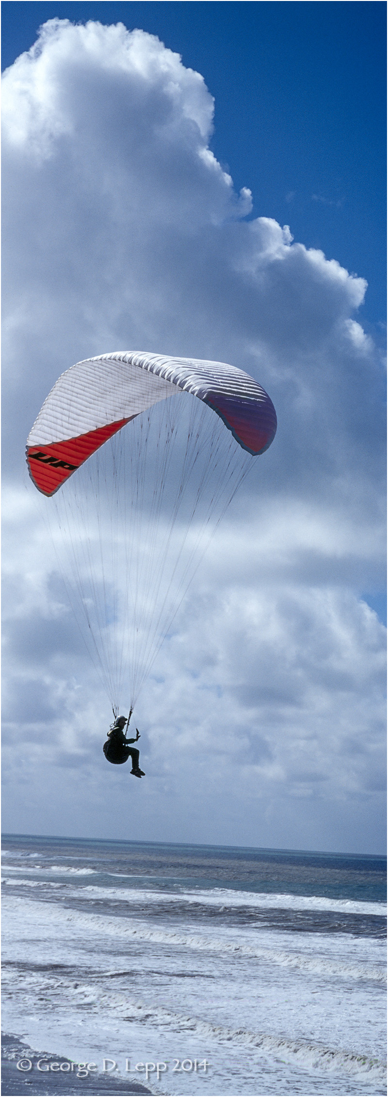 Paraglider along coastline at Montana de Morro, CA. © George D. Lepp 2014 VA-PA-0002