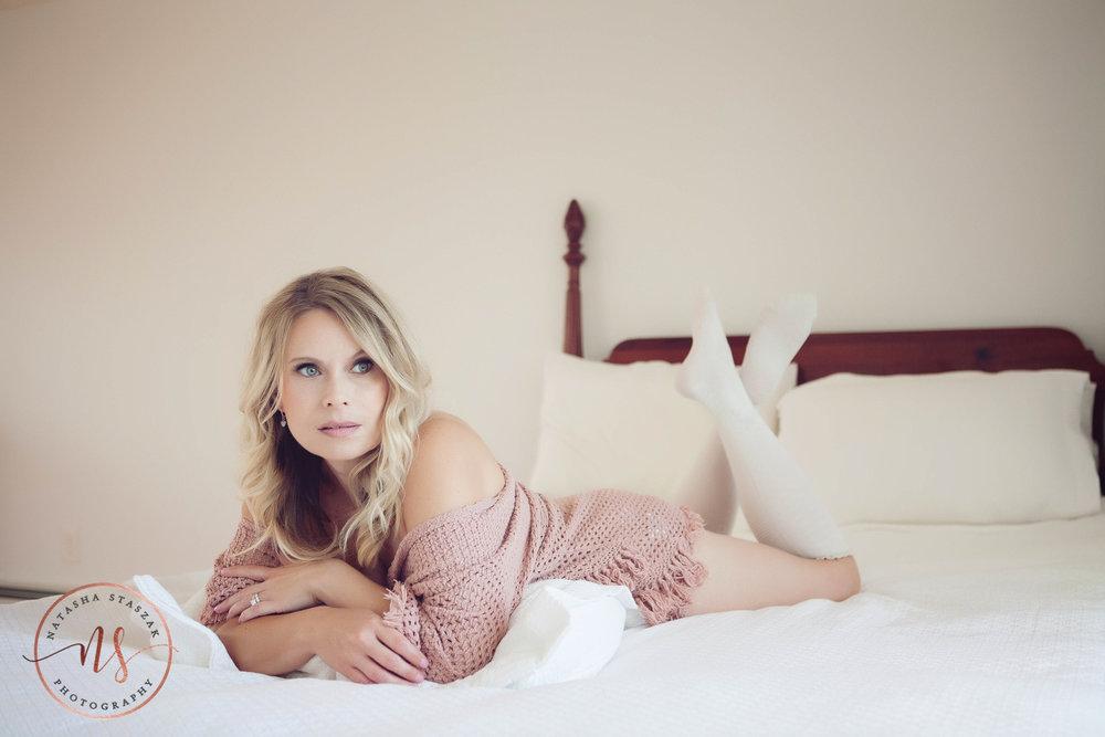 Boudoir Portraits | Woman lying on bed wearing pink wrap | Boudoir Behind the Scenes Info | Buffalo NY Boudoir Photographer | Natasha Staszak Photography