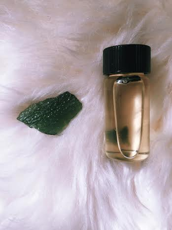 Moldavite specimen with Moldavite infused oil.